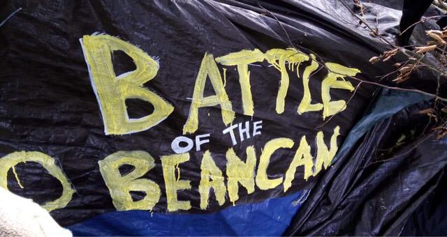 A black sign saying 'Battle of the Beancan'
